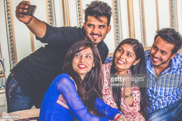A group of friends from India are smiling and taking a selfie together. Indian culture and viewpoint on the world