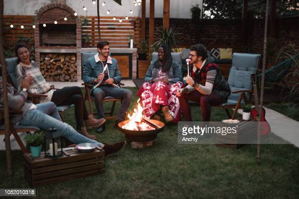 Group of Friends Gathered Around a Fire Pit