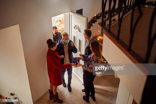 group of friends gathering for new years party - 25 29 years stock pictures, royalty-free photos & images