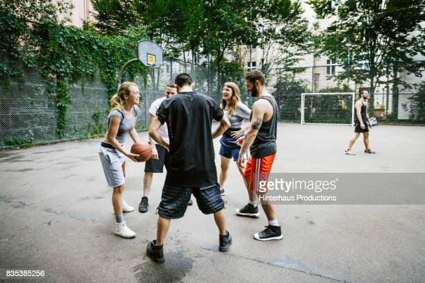 Group Of Friends Getting Ready To Play Basketball Together