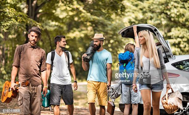 Group of friends going on camping in the forest.