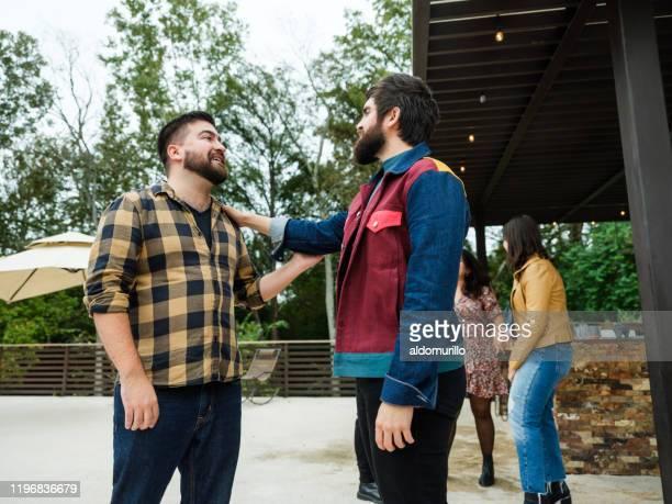 group of friends greeting each other - carne assada imagens e fotografias de stock