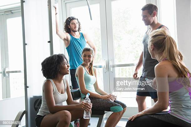 Group of friends hanging out at the gym