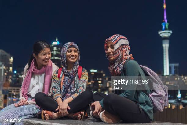 group of friends hanging out in auckland city - holy city stock pictures, royalty-free photos & images
