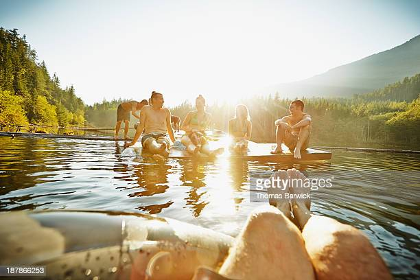 Group of friends hanging out on floating dock