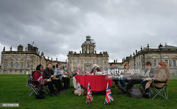 Group of friends have a picnic as they attend the annual classical Proms Spectacular concert held on the north lawn of Castle Howard on August 20...