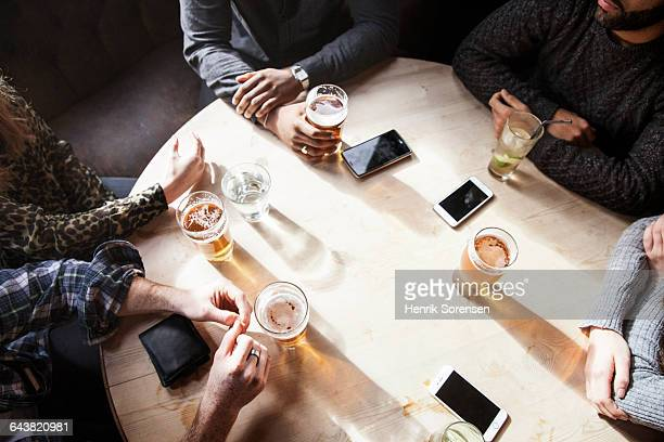 Group of friends have beers