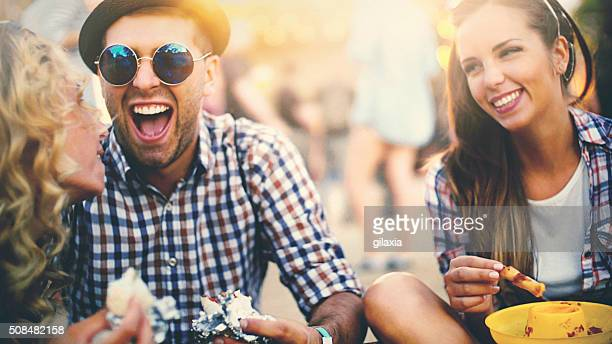 group of friends having a bite. - man eating woman out stock photos and pictures