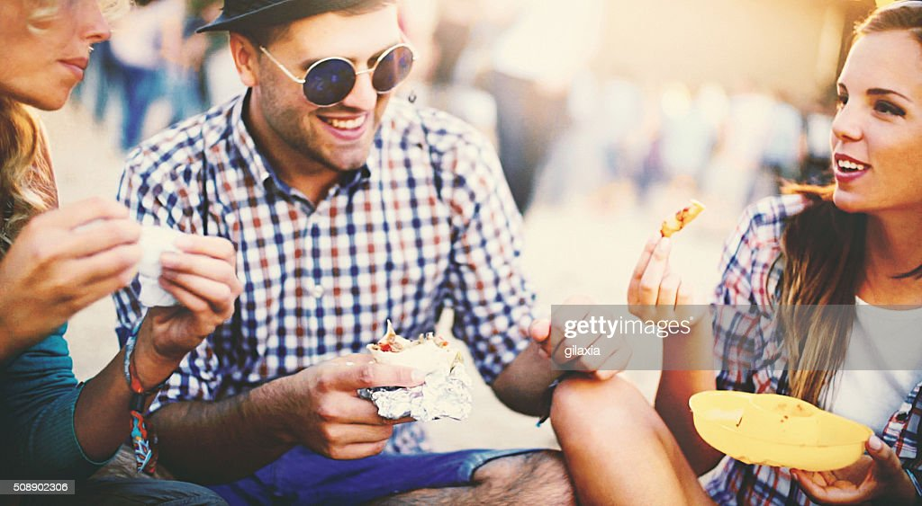 Group of friends having a bite. : Stock Photo