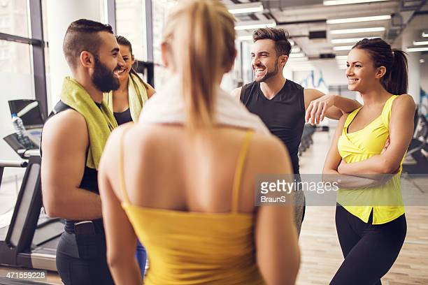 Group of friends having a break in gym and communicating.
