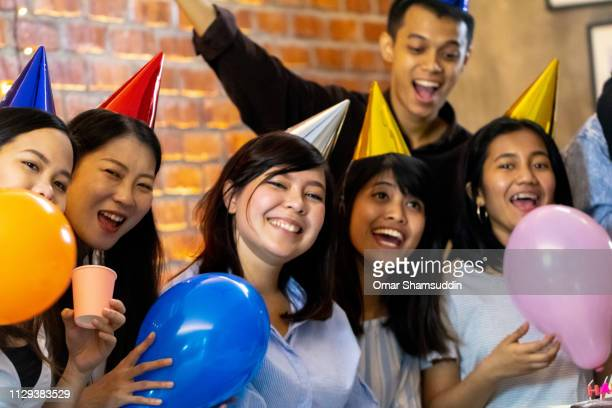 Group of friends having a good time at birthday party