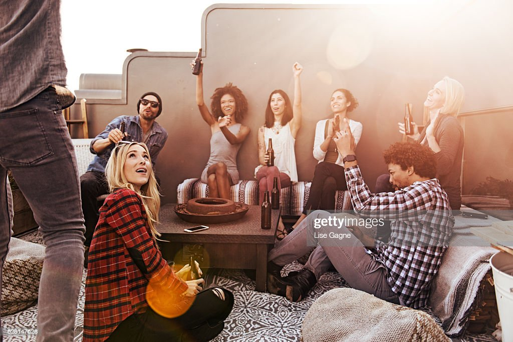 Group of friends having beers and pizza : Stock Photo