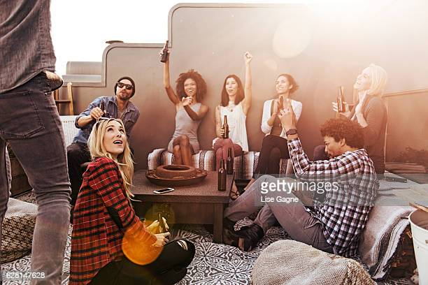 Group of friends having beers and pizza