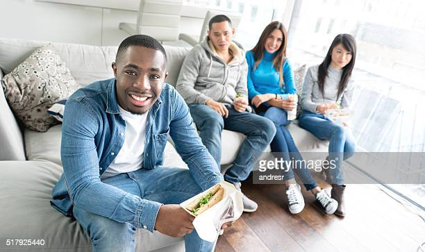 Group of friends having dinner at home