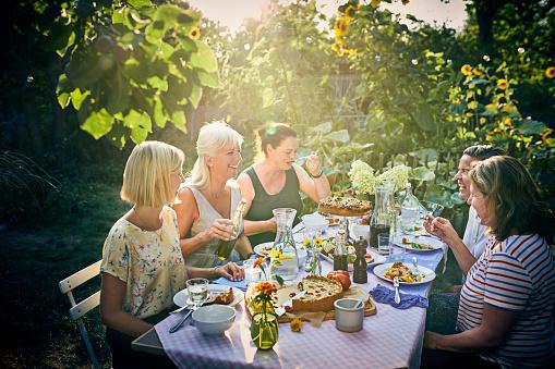 Group of friends having dinner in garden - gettyimageskorea