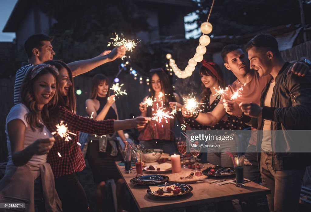 Group of friends having dinner party in backyard : Stock Photo