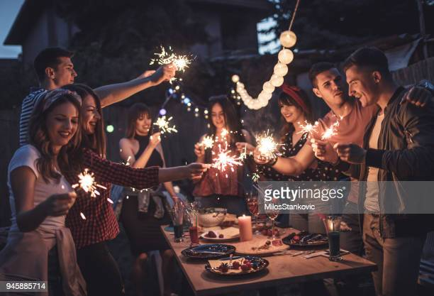 group of friends having dinner party in backyard - outdoor party stock pictures, royalty-free photos & images