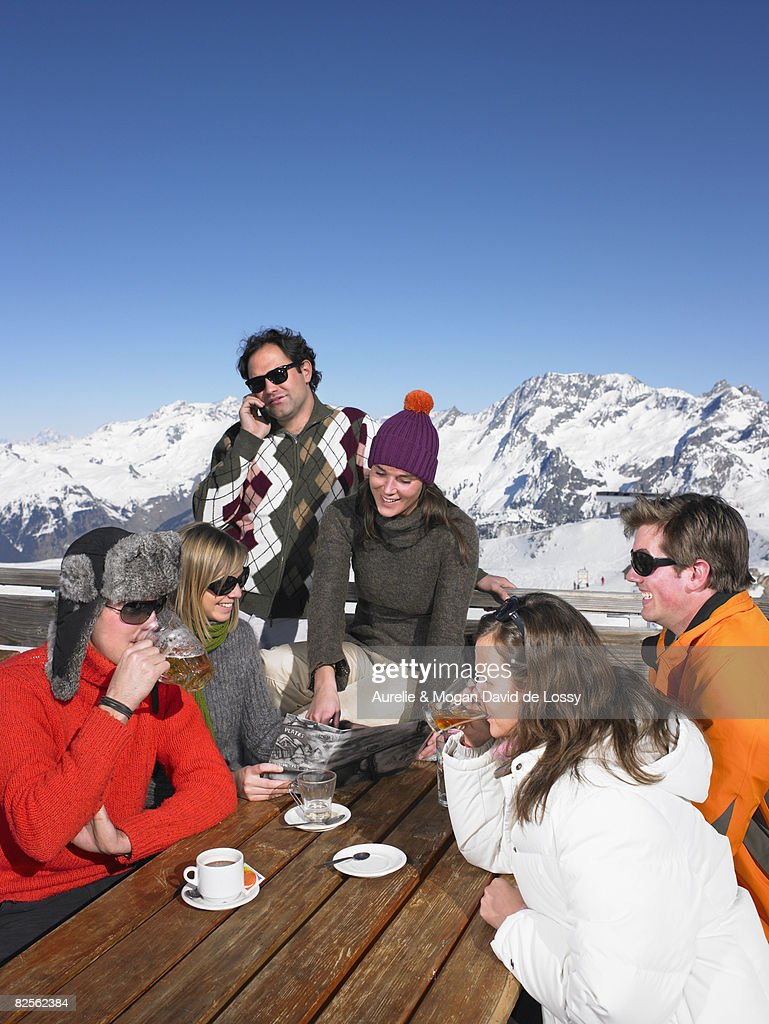 Group of friends having drink on terrace : Stock Photo