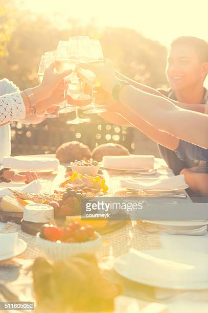 Group of friends having drinks at sunset.