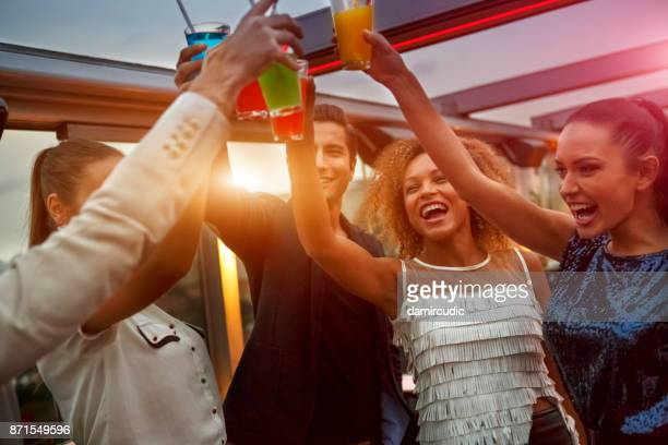 group of friends having drinks at the night club party - cocktail party stock pictures, royalty-free photos & images