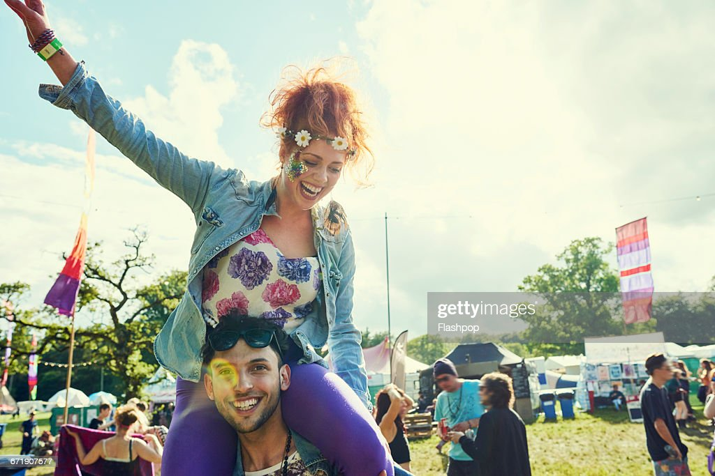 Group of friends having fun at a music festival : Stock Photo