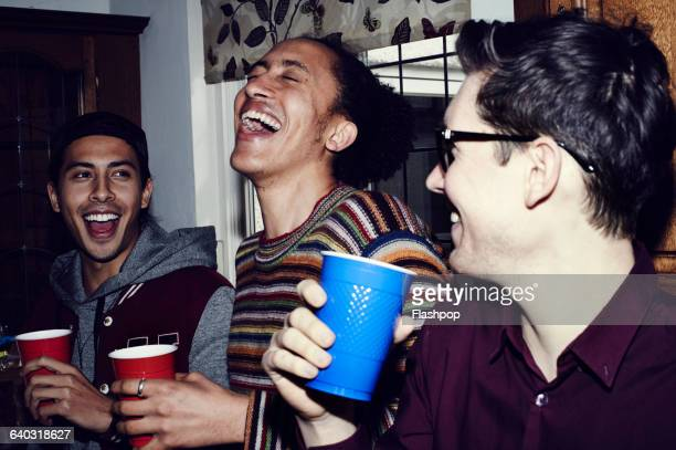 group of friends having fun at a party - party stock pictures, royalty-free photos & images