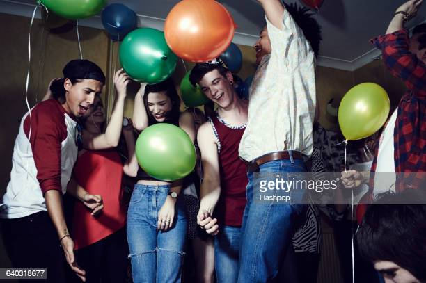 Group of friends having fun at a party