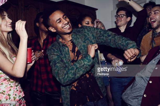 group of friends having fun at a party - dancing stock photos and pictures