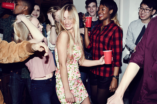 Group of friends having fun at a party - gettyimageskorea