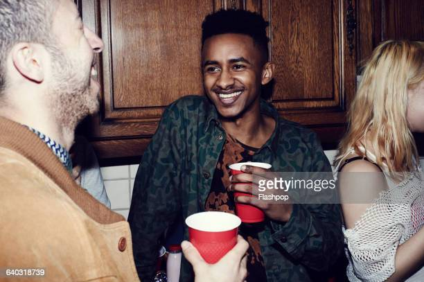group of friends having fun at a party - disposable cup stock pictures, royalty-free photos & images