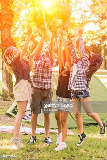 group of friends having fun at camping - pjphoto69 stockfoto's en -beelden