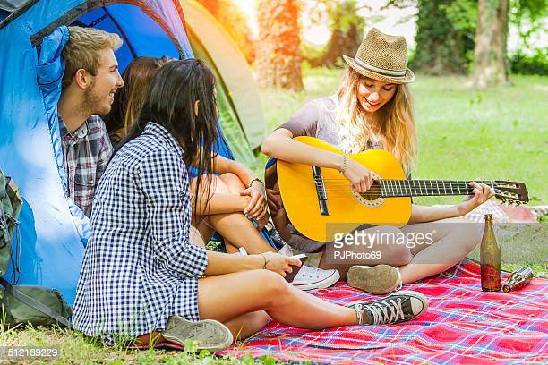 Group of friends having fun at camping