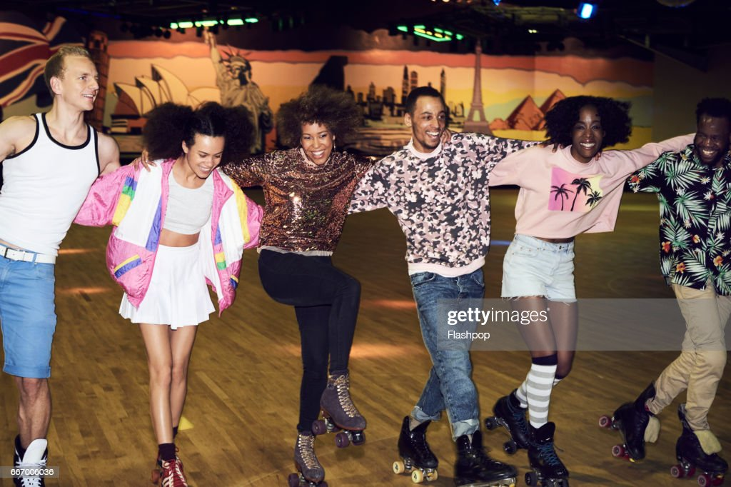 Group of friends having fun at roller disco : Foto de stock