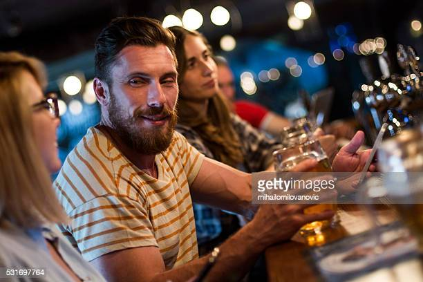 group of friends having fun at the bar - flirting stock pictures, royalty-free photos & images