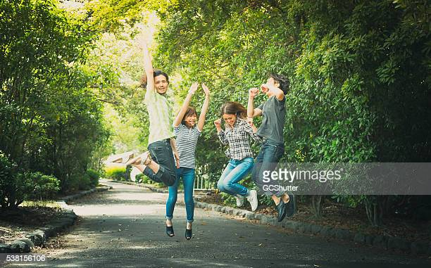 Group of friends having fun at the park