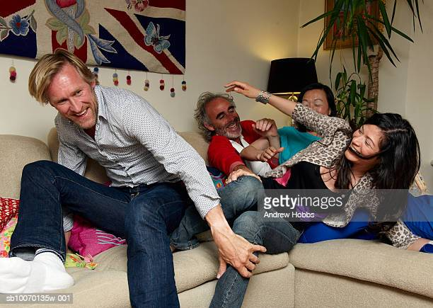 Group of friends having fun in living room