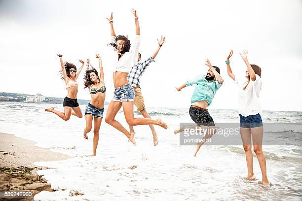 Group of friends having fun in the sea