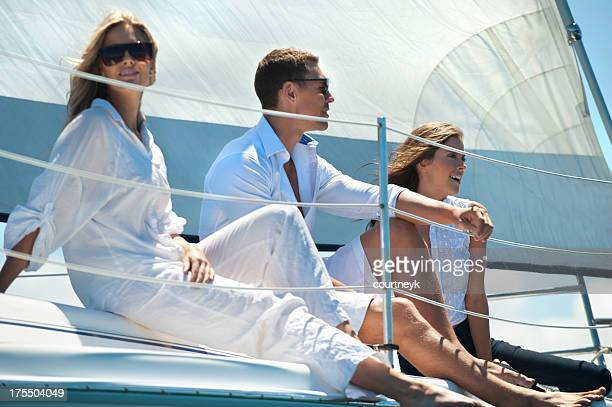 Group of friends having fun on a yacht