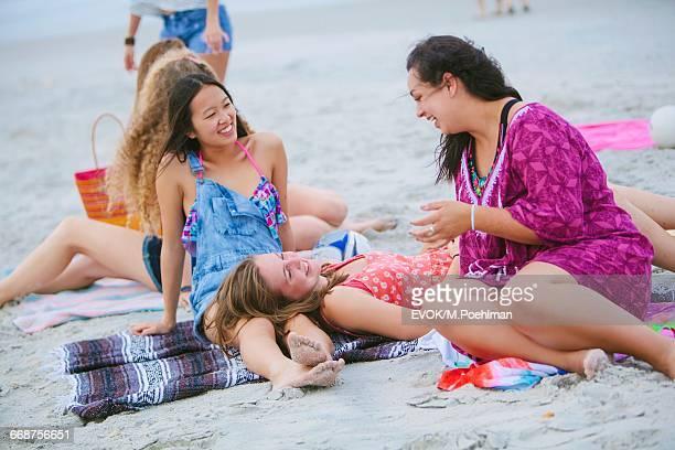 Group of friends (16-17) having fun on beach
