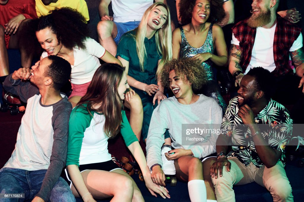 Group of friends having fun on evening out : Stock Photo