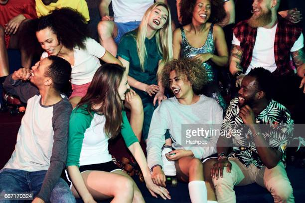Group of friends having fun on evening out