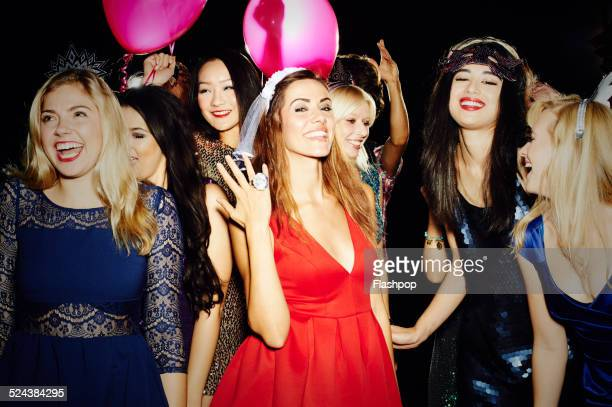 group of friends having fun on hen night out - black women engagement rings stock pictures, royalty-free photos & images