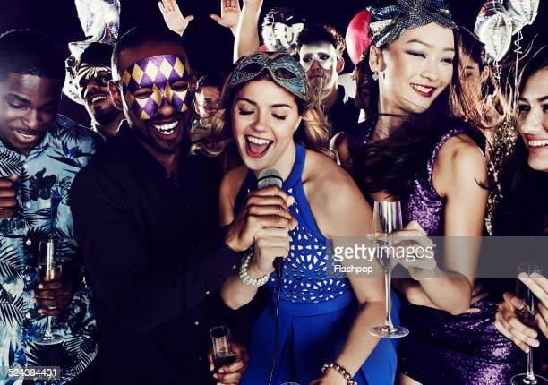 group of friends having fun on night out. karaoke. - karaoke stock pictures, royalty-free photos & images