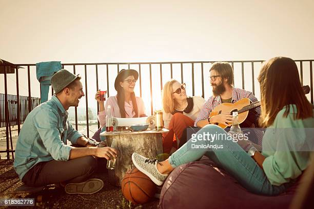 group of friends having fun on the roof