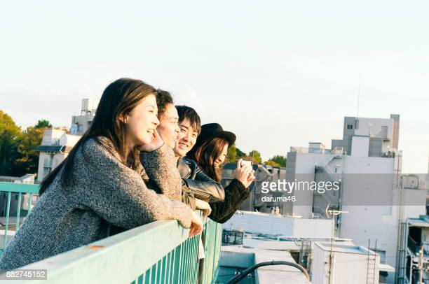 Group of friends having fun on urban rooftop