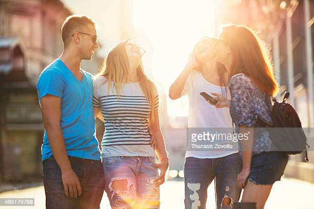 Group of friends having fun outdoors in urban setting