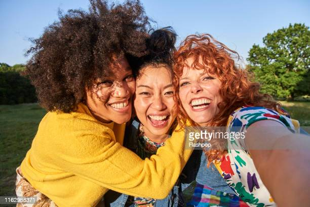 group of friends having fun - mid adult stock pictures, royalty-free photos & images