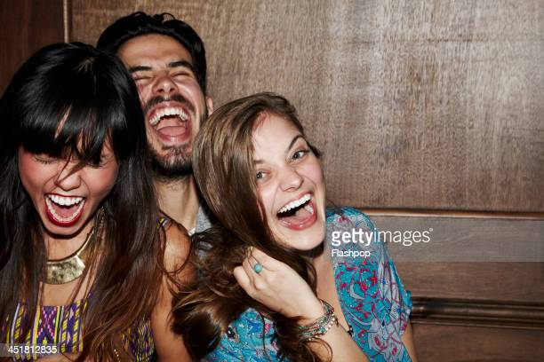 group of friends having fun - three people stock pictures, royalty-free photos & images