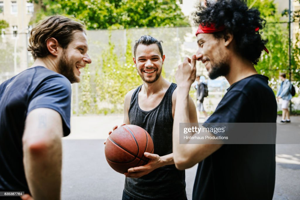 Group Of Friends Having Fun Together At An Outdoor Basketball Court : Stock Photo