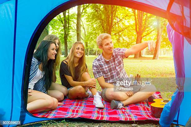 group of friends having fun with smartphone at camping - pjphoto69 個照片及圖片檔
